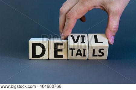 Devil In The Details Symbol. Businessman Hand Turns Cubes And Changes The Word 'details' To 'devil'.