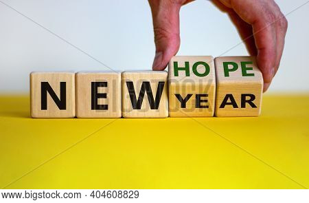 New Year And Hope Symbol. Businessman Turns Cubes And Changes The Words 'new Year' To 'new Hope'. Be
