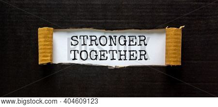 Stronger Together Symbol. Words Stronger Together Appearing Behind Torn Black Paper. Business, Motiv