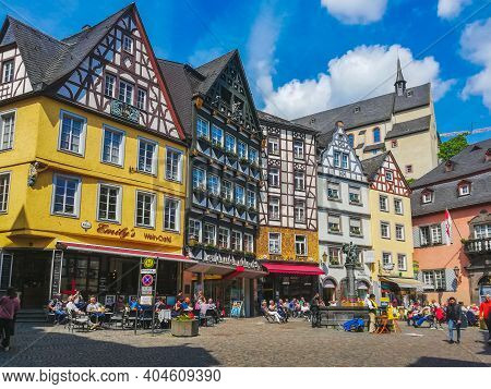 Cochem, Germany - May 23 2019: Idyllic Old Town Square With Different Shops And Restaurants. Cochem