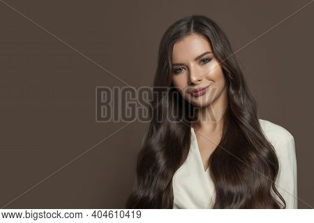 Cheerful Brunette Model Woman With Long Healthy Hair Smiling On Brown Background, Fashion Beauty Por