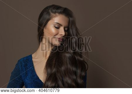 Fashionable Brunette Model Woman With Long Curly Hair On Brown Background, Fashion Beauty Portrait