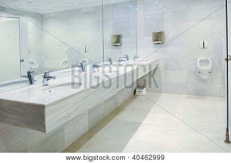 Public Empty Men Restroom With Washstands Mirror