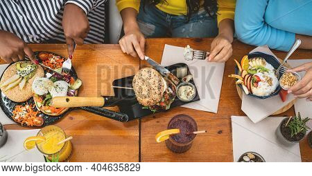 Top View Of Multiracial Friends Having Healthy Lunch In Coffee Brunch Bar - Young People Lifestyle A