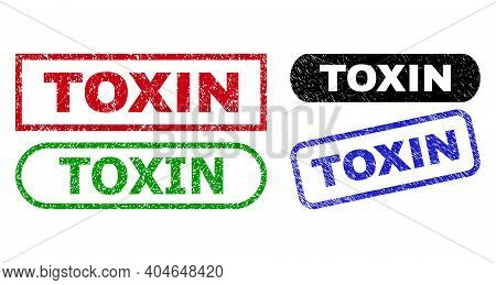 Toxin Grunge Stamps. Flat Vector Scratched Seal Stamps With Toxin Caption Inside Different Rectangle