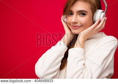 Closeup Photo Of Cute Attractive Positive Smiling Young Blonde Woman Wearing White Hoodie Isolated O