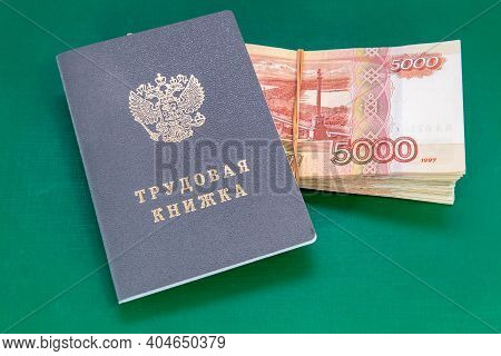 Labor Book And Russian Money On The Table. Payments Under An Employment Contract/ Russian Translatio
