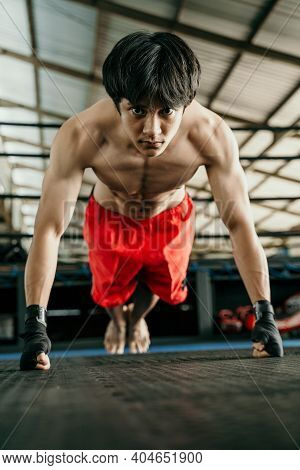 Muscled Boxer Wearing Black Strap On Wrist Do Push Up When Warming Up