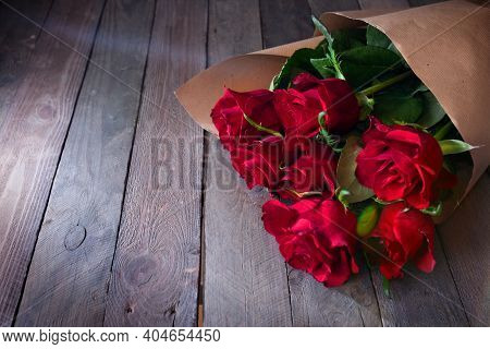Bunch Of Red Roses On Vintage Wood. Background For Valentines Day And Mothers Day With Space For You