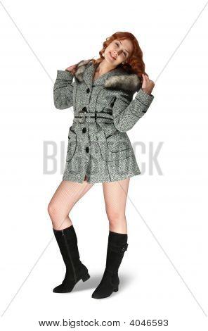 Girl In Gray Coat On White Background