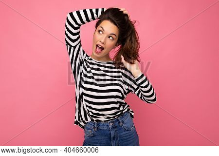 Young Beautiful Brunet Woman. Trendy Lady In Casual Striped Longsleeve. Positive Female Shows Facial