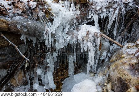 Icicles And Powerful Ice Build-up On A Stream In Winter