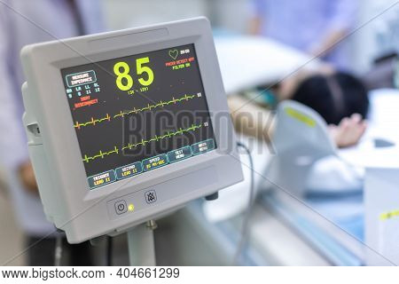 Electrocardiogram In Hospital Ct Scan Room. Heart Rate Monitor In Hospital. Process Of Ct Scanning O
