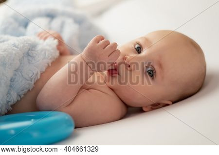 Baby Sucking His Thumb On White Background