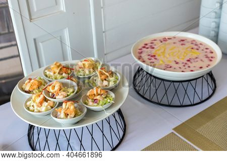 Fried Shrimp Salad In A Cocktail Bowl. Shrimp Ceviche Served In Cocktails. Shrimp Cocktail Served Wi