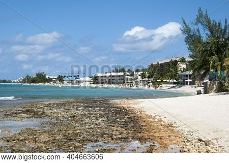The Rocky And Sandy Seven Mile Beach Stretches In George Town On Grand Cayman Island (cayman Islands