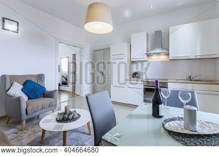 Modern Kitchen Interior With Table And Wine