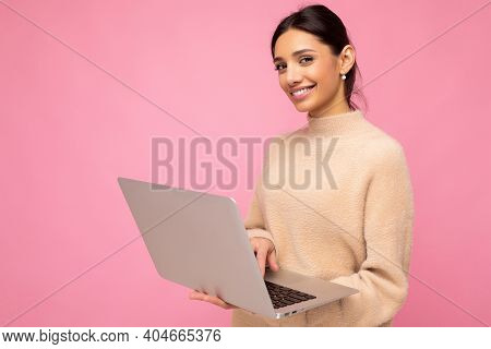 Close-up Portrait Of Beautiful Smiling Young Brunette Woman Holding Netbook Computer Looking At Came