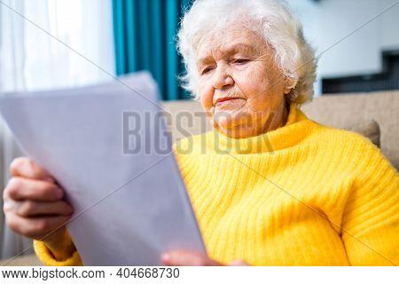 Old Senior Woman Hands Wrinkled Skin Close Up On Knees.