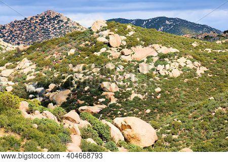 Large Rocks And Boulders On Arid Hillsides Covered With Chaparral Plants Taken On Rural Badlands At