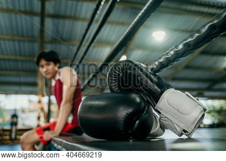 Black Boxing Gloves On Boxing Ring In Gym