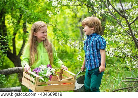 Two Little Children On Countryside Farm. Cute Toddler Girl And Boy Working On Farm Outdoors. Childho