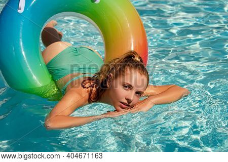 Summer Sensual Woman In Pool. Summertime Girl Swimming Pool. Summer Leisure And Holiday