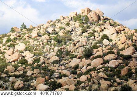 Barren Hillside Covered With Large Boulder Rocks And Chaparral Plants Taken On Arid Badlands At The