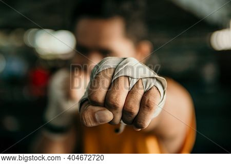 Close Up Of Hand Boxer In Wrapping Bandage Make A Jab Motion