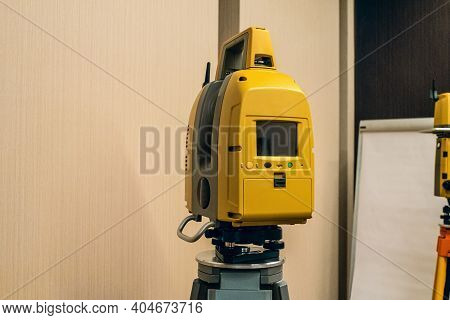 Yellow Electronic Total Station. Modern Geodetic Instrument For Measuring Distances, Horizontal And