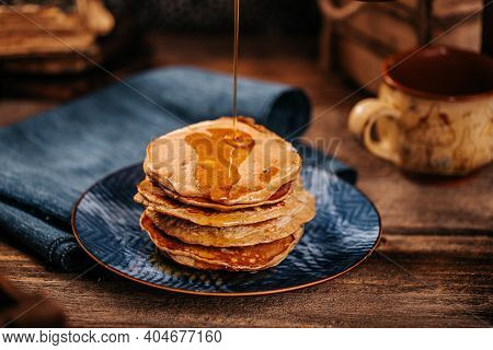 Women Stream Delicious Mapple Syrup For Home Made American Pancakes
