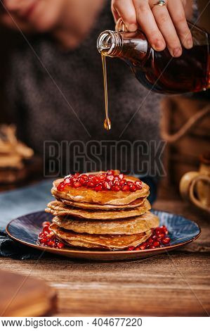 Women Stream Delicious Mapple Syrup For Home Made American Pancakes With Pomegranate