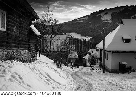 Log Cabin Houses In Vlkolinec, Traditional Settlement Village In The Mountains.black And White Photo