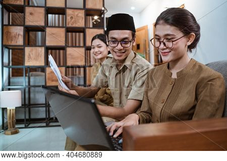 Some Teachers In Civil Servant Uniforms Work On A Computer Laptop And Paperwork