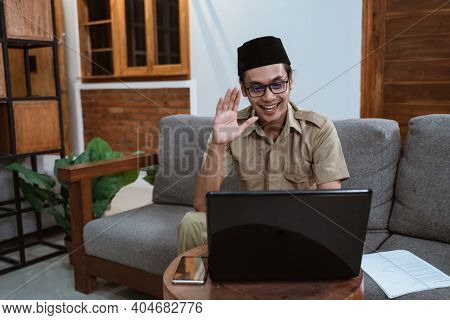 Man In Government Employee Uniforms Presenting Online Meetings Using Laptop Computers