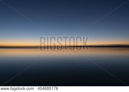 Sunrise Abstract Over Bay In Peaceful Calming Background Image.