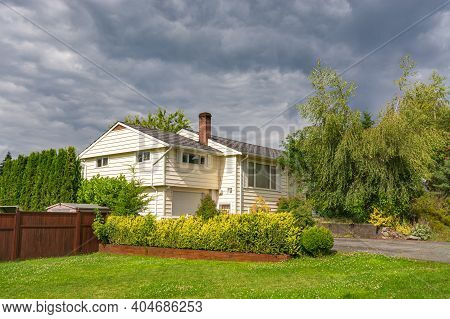 Old Family House With Green Lawn In Front