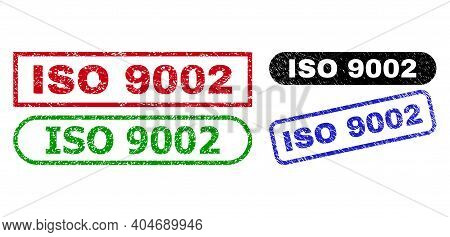 Iso 9002 Grunge Stamps. Flat Vector Grunge Stamps With Iso 9002 Message Inside Different Rectangle A