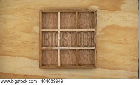 A Wooden Box With Empty Compartments, Suitable For Creating A Concept Or A Board Game Of Noughts And