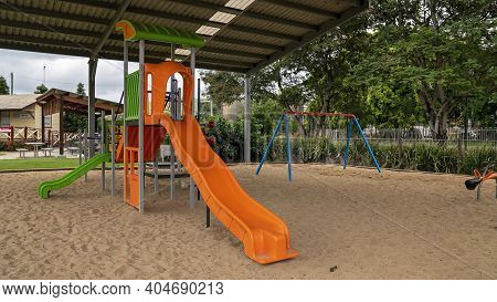 Mackay, Queensland, Australia - January 2021: A Playground For Children With Slippery Slide And Swin