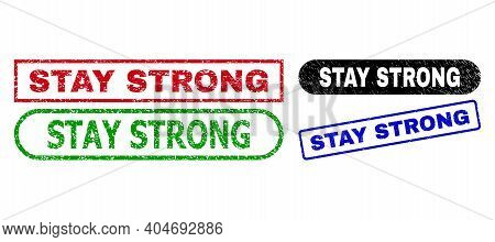Stay Strong Grunge Stamps. Flat Vector Scratched Stamps With Stay Strong Phrase Inside Different Rec