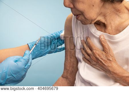 Nurse Is Doing Vaccine Injection To Senior Woman.