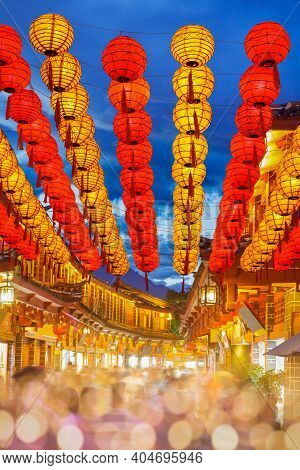 Lijiang Old Town In The Evening With Crowd Tourist , Yunnan China.