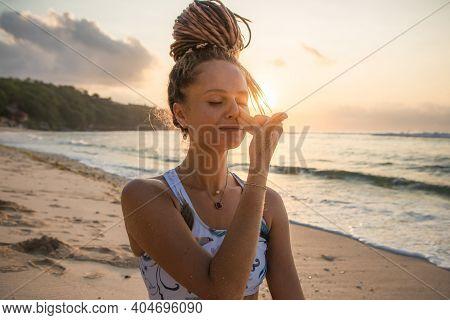 Yogi Woman Practicing Nadi Shodhana Pranayama, Alternate Nostril Breathing. Control Prana, Control O