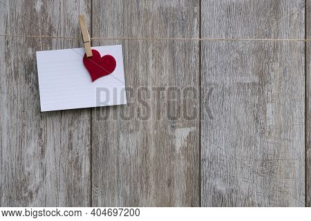 Empty Card Lies Over Red Cloth Heart Over Wooden Lettering 'i Love You