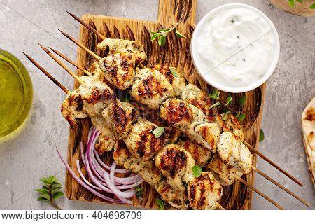 Greek Chicken Souvlaki On Wooden Skewers With Tzatziki Sauce