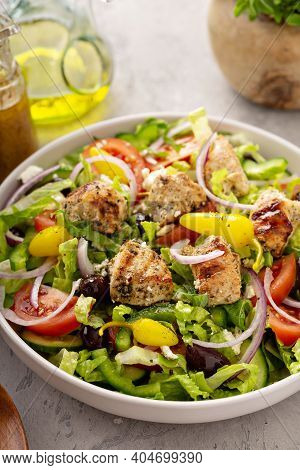 Greek Salad With Vinaigrette Dressing Topped With Grilled Chicken Souvlaki
