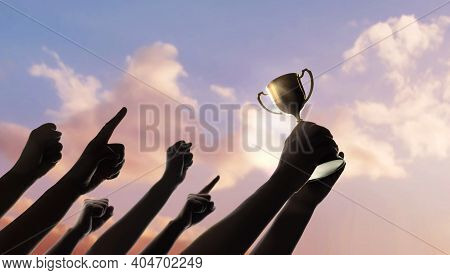 Teamwork, Winning, Goal And Successful Concept.  Silhouette Of People Raise Up Hands Into The Sky. T
