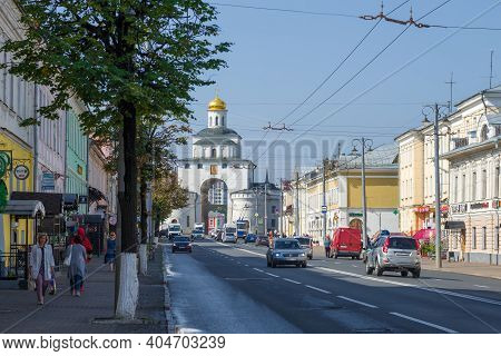 Vladimir, Russia - August 28, 2020: Ancient Golden Gate Of Vladimir In The Cityscape On A Summer Day