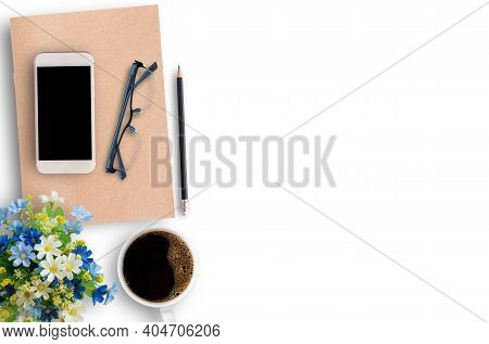 Office Desk Table With Smartphone, Coffee Cup,glasses,flower And Office Supplies On White Office Tab